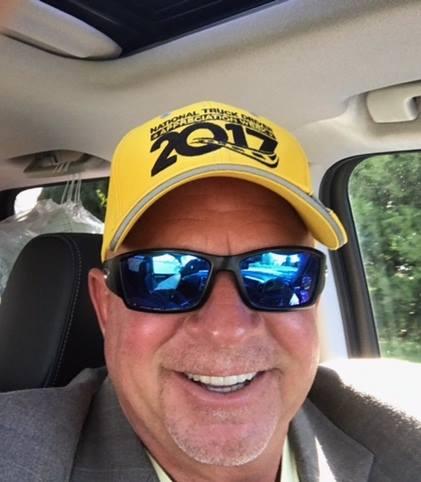 Smiling Ed Remster wearing cap