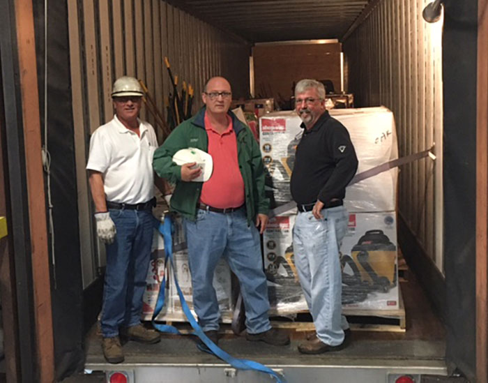 Three men inside truck during Hurricane Harvey relief