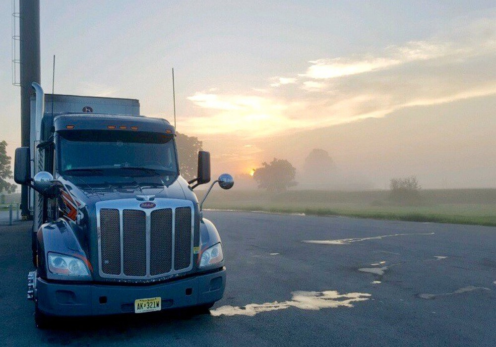 Truck with early morning fog and sunshine