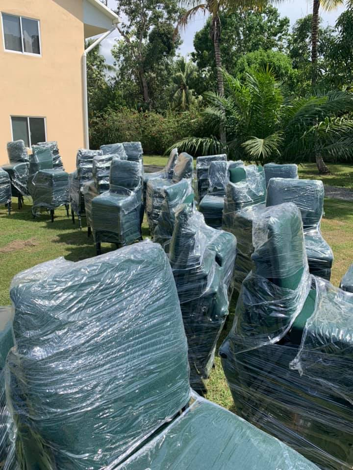 Donation of chairs still wrapped in plastic wrap