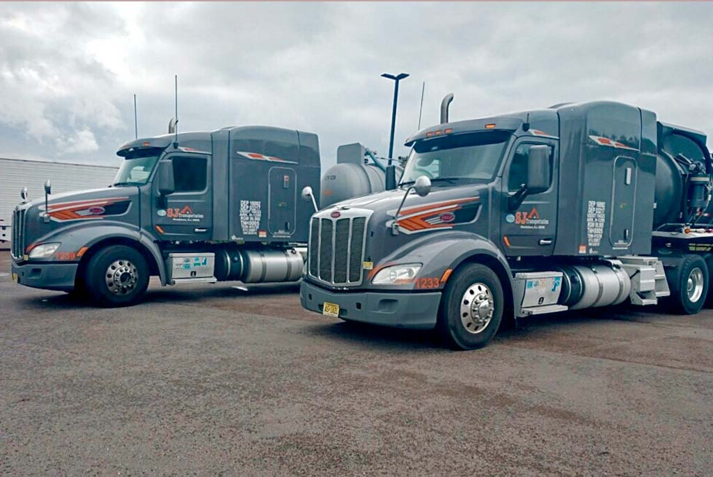 Two SJ trucks at truck stop in Maryland. Photo by Joe Stroup
